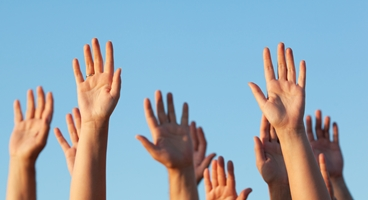 People holding up their hands. Used in CX feedback.